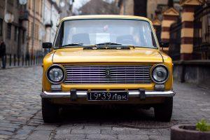A vintage yellow car