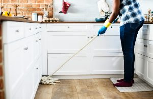 woman cleaning kitchen floors