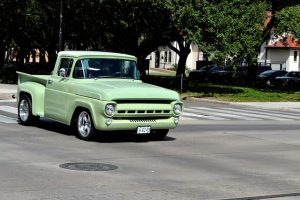 An old school lime green pick up truck.