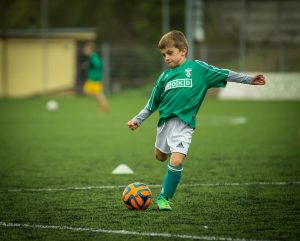 A boy playing soccer.