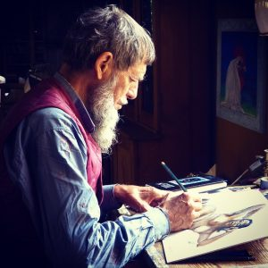 A man drawing on paper