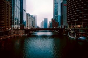 Calm water surface of a river in Chicago and some beautiful bulidings - moving out of Chicago may be difficult