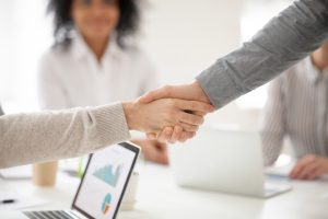 Two people handshake after a meeting