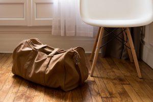 A duffel bag on the floor.
