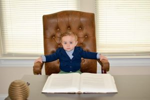 a kid in a CEO chair