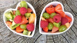 Two portions of fruits, heart-shaped