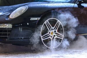 Smoke around car tires.