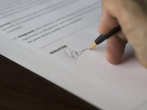 Signature - Avoid problems when signing a commercial real estate lease by understanding it.