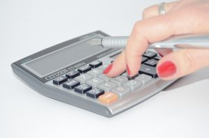 A calculator to do some calculations and decide whether to buy or rent an art studio in NYC.