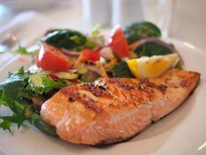 Salmon dish on a plate in a restaurant.