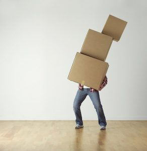 Man balancing cardboard boxes