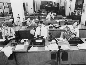Black and white picture of an old office without any modern technology.