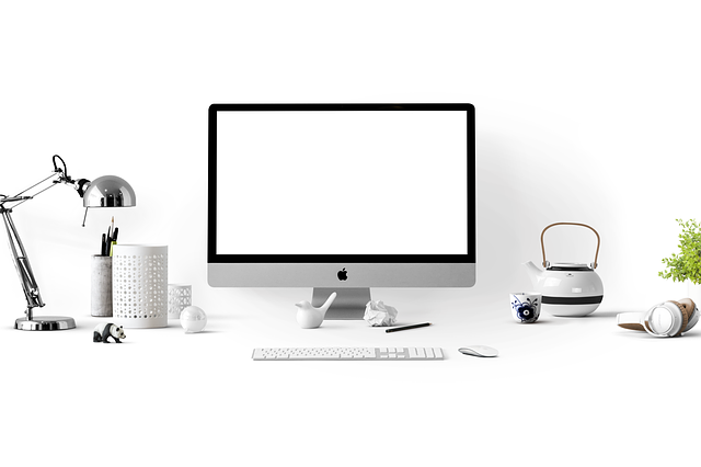 Apple devices in a white office.