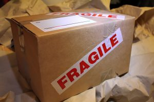 A box labeled fragile which could contain your more valuable books.