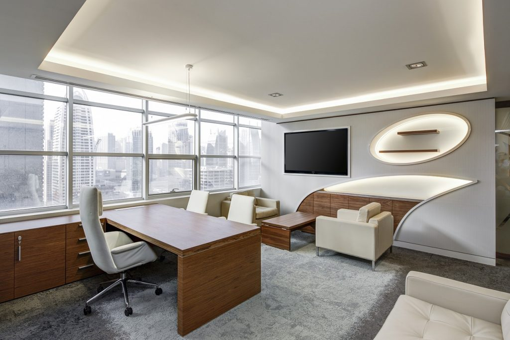 An office with a large desk inside as you need to know how to pack and move a large office desk during an office relocation.