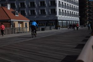 A man cycling as you will do once you move to  Huntington NY with your family.