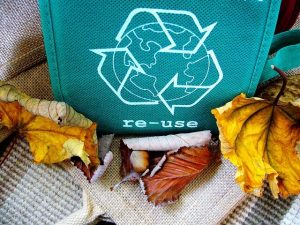 A bag with the recycling sign on it.