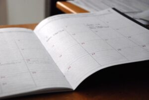 A calendar in a planner to make a plan when moving musical instruments overseas.