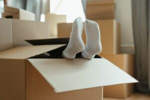 Decluttering your home with boxes and a kid.