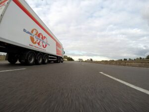 A moving truck on the road as it is one of the best way to transport your belongings.