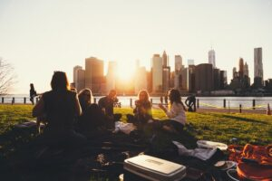 people sitting on grass in New York