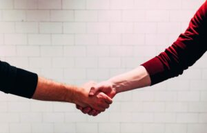 A handshake with a new business partner once you relocate your NYC company to Japan