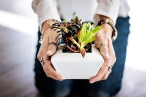 A woman holding plants.
