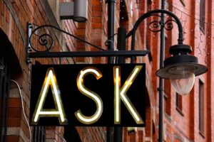 Ask sign on a building.