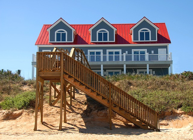 A beach, sand, stairs, and grass in front of a vacation house in New Jersey.