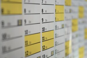 A calendar on the wall to set the moving date for your family relocation to New York.