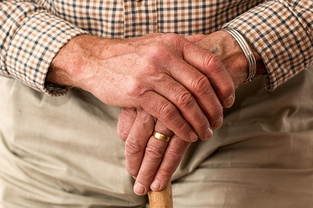 Adapt your home for an elderly family member holding a cane.