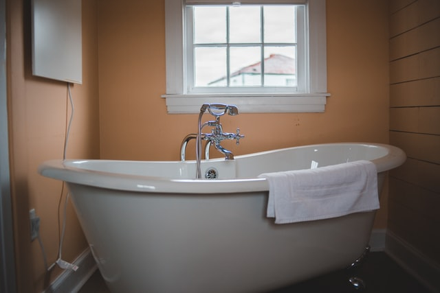 A white ceramic bathtub