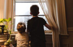 kids looking through the window