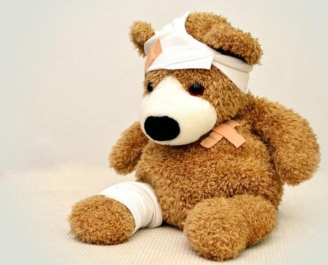 Injured teddy bear.