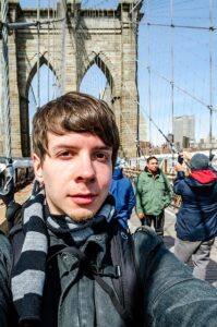 Man on the Brooklyn Bridge is preparing for surviving NYC.