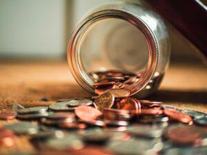 Coins spilt from a jar