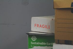 Boxes. One of them is labeled as Fragile. Moving from Miami to NYC can be considered fragile if you're not careful.