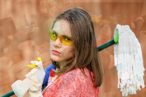 A woman with some cleaning supplies, getting ready to clean or search for home cleaning services to use when moving
