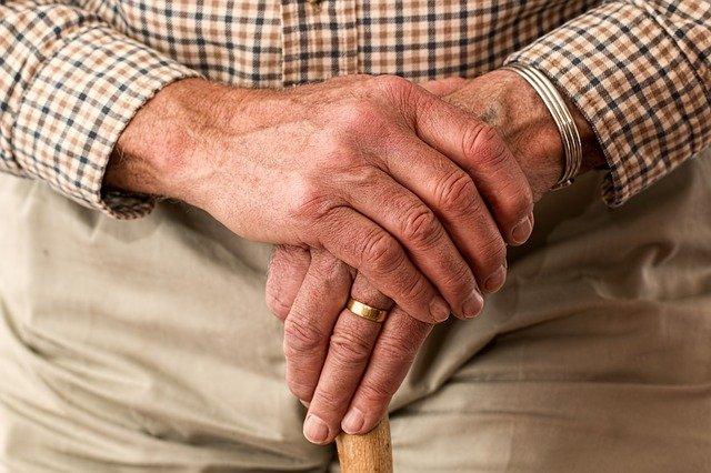Elderly man holding a cane