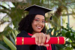 a woman holding a red diploma