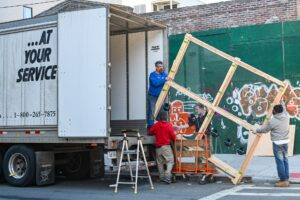 movers packing household items for NYC to California move